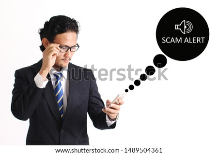 Scam Alert concept with young man holding smartphone on white background #1489504361