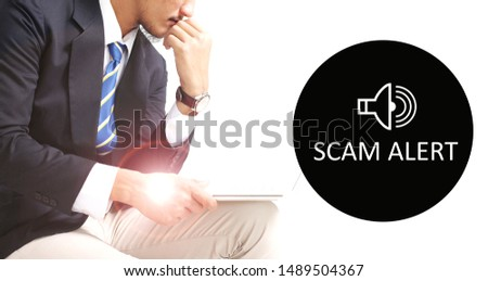 Scam Alert concept with young man working with laptop on white background #1489504367