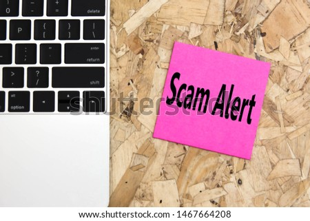 Scam Alert on keyboard background.  Sticker note paper Scam Alert on laptop for copy space. Internet fraud hacking scams concept.  top view. #1467664208