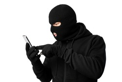Scam Concept. Masked villain touching a smart phone screen, isolated on white studio background