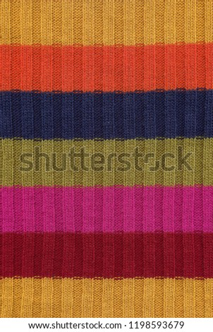 Scan of rainbow striped colorful knitted wool texture with red, magneta, green, blue, orange and yellow stripes. #1198593679
