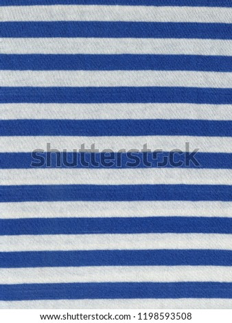 Scan of striped sailor`s vest fabric texture with white and blue stripes pattern #1198593508