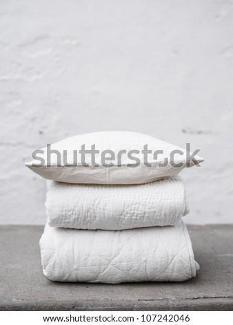 Scandinavia, Sweden, Stockholm, Folded blankets and quilt, close-up