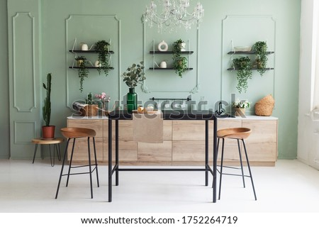 Scandinavian classic kitchen with wooden decor and green plants, minimalistic interior design. Real photo. Eco home decor. Photo stock ©