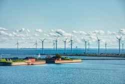 Scandinavian Danish offshore wind farm or wind power station for green, eco friendly energy production. Electricity production by renewable natural resources in a wind power plant. Copenhagen, Denmark