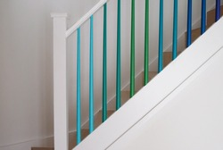 Scandinavian inspired minimalist staircase, ombre colours, blue stairs, green stairs, stair spindles