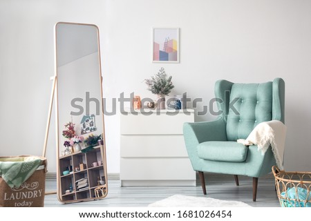 Scandinavian living room. Christmas living room. Stylish room in white color with armchair and bright. White modern living room. Scandinavian interior design.