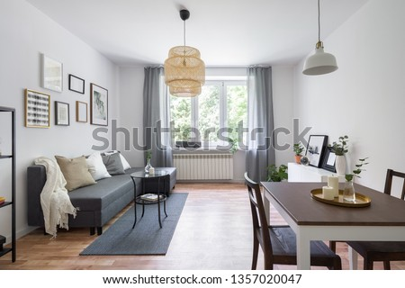 Scandinavian living room with wooden dining table and decorative bamboo lamp #1357020047