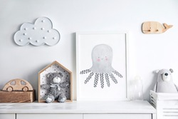 Scandinavian newbornbaby shelf  with mock up photo frame, wooden accessories and toys, teddy bears and cloud. White and cozy childroom.