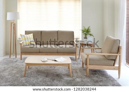Scandinavian style livingroom with fabric sofa, sofa table.  #1282038244