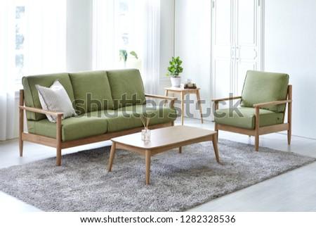 Scandinavian style livingroom with fabric sofa, sofa table.  #1282328536
