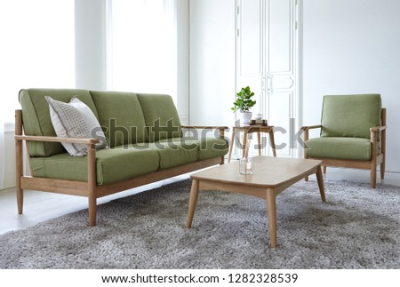 Scandinavian style livingroom with fabric sofa, sofa table.