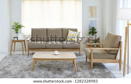 Scandinavian style livingroom with fabric sofa, sofa table.  #1282328983