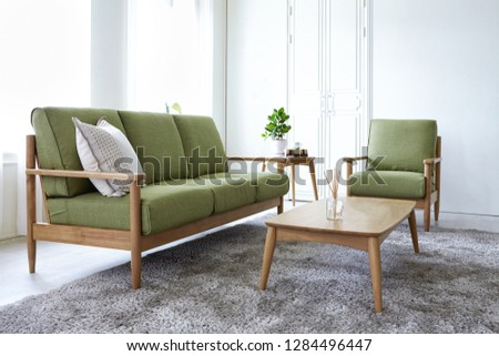 Scandinavian style livingroom with fabric sofa, sofa table.  #1284496447