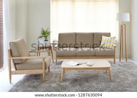 Scandinavian style livingroom with fabric sofa, sofa table.  #1287630094