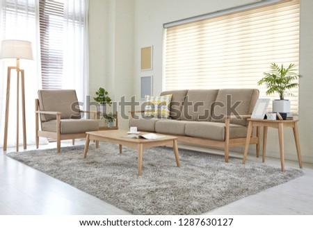 Scandinavian style livingroom with fabric sofa, sofa table.  #1287630127