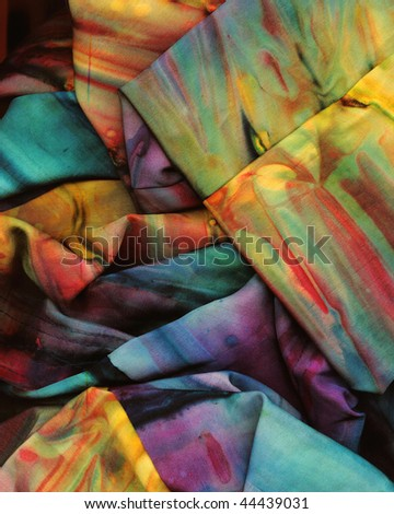 Scanned detail of a crumpled silk sari dyed in a random rainbow of colors