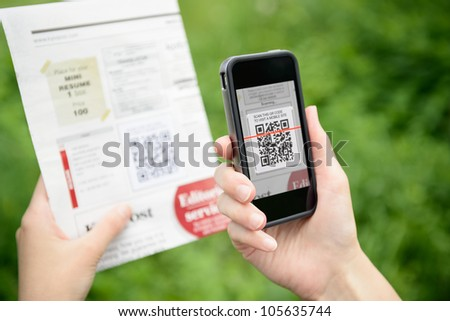 Scanning advertising with quick response code on mobile smart phone.