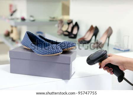 Scanning code on shoe box, cropped view