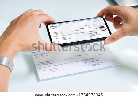 Scanning Remote Deposit Check Document Using Phone. Taking Photo