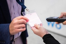 Scanning visitor pass to enter an event or conference