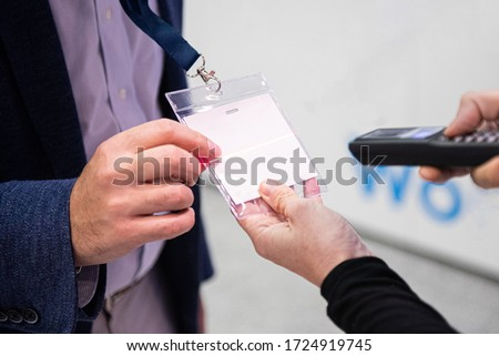 Scanning visitor pass to enter an event or conference Foto stock ©