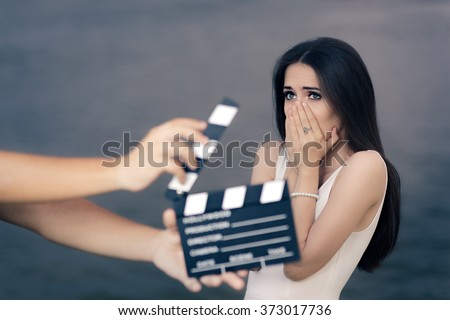 Scared Actress Shooting Movie Scene  - Young professional cinema star acting sad in a drama film