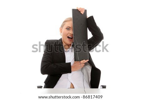 Scared business woman covering her face with keyboard, isolated on white background