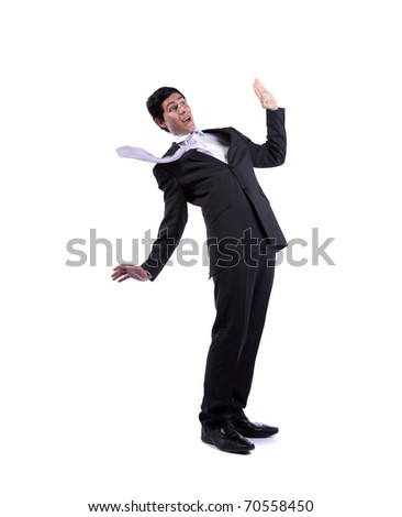 Scared businessman in a falling position (isolated on white)