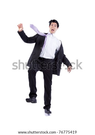 Scared businessman in a falling position (isolated on white) - stock photo