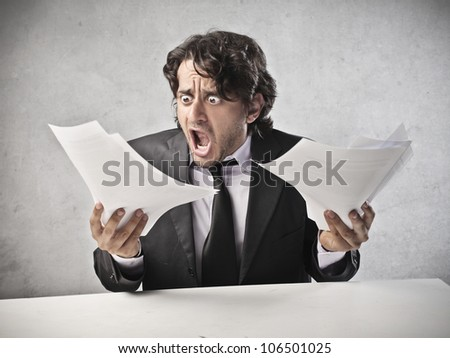 Scared businessman looking at some documents