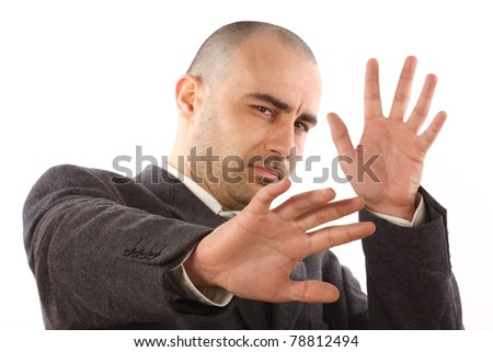 scared businessman on white background. Focus on the left hand