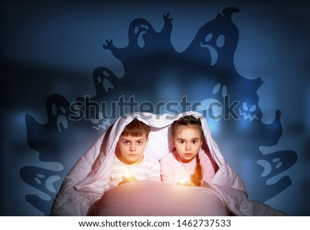 Scared children in pajamas with flashlights hiding under blanket. Frightened kids sitting in bed. Children and boo ghosts above them. Comic evil spirits silhouettes on background. Childhood fears. #1462737533