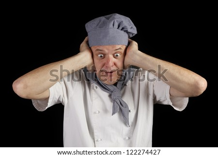 Scared cook is holding his head because he ruined meal - stock photo