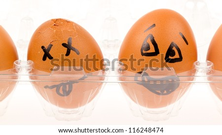 Scared egg looking at it's dead buddy, isolated