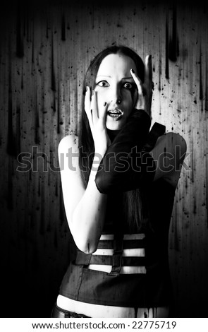 Scared goth woman portrait. Background with dirty spots.
