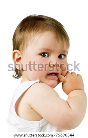Scared little boy with his finger in his mouth, isolated on white.