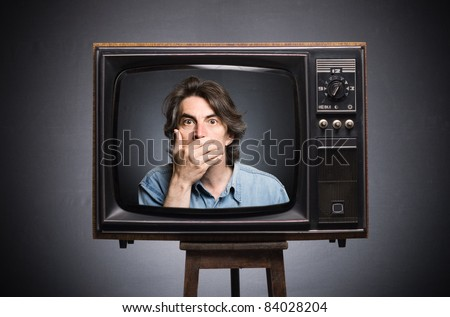 Scared man in old TV screen.