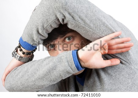 scared man that covers his face with the hands