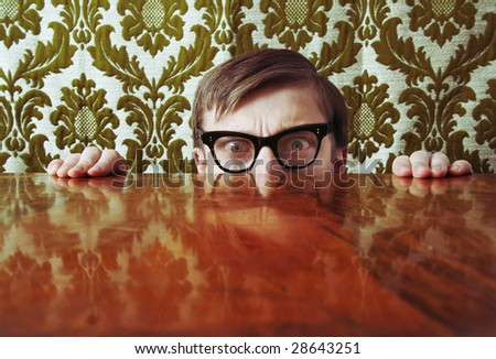 Scared nerd hiding behind a desk, similar available in my portfolio