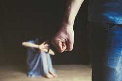 Scared woman protecting from mans aggression. Domestic violence concept