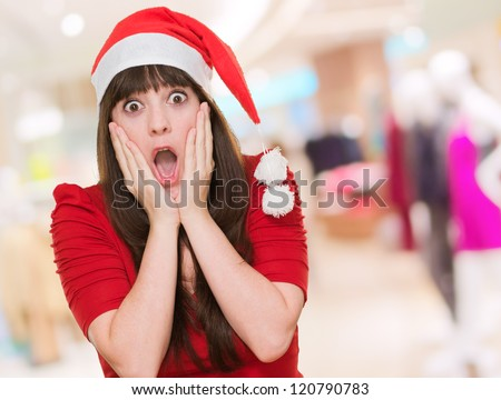 scared woman wearing a christmas hat at the mall, indoor
