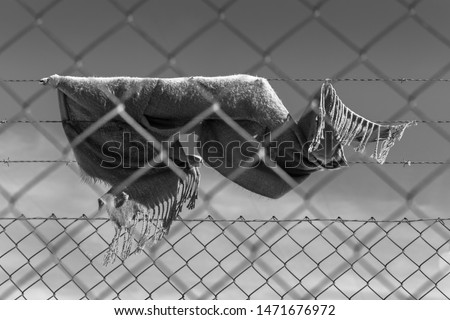 scarf hooked to a fence after an escape attempt #1471676972