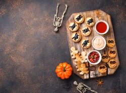 Scary appetizers for Halloween party. Festive food for 31 October