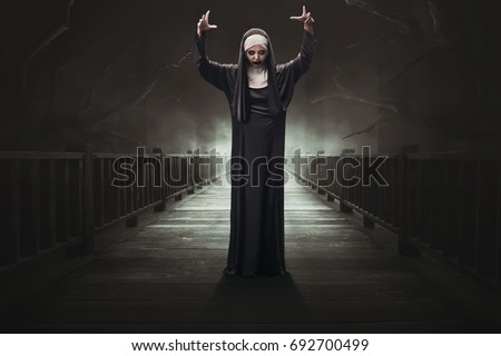 Scary asian woman devil nun on the dark forest #692700499