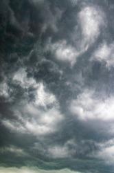 Scary beautiful storm clouds. Gloomy dark sky hurricane