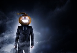 Scary businessman with pumpkin head