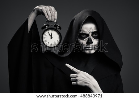 Stock Photo Scary Death Hold A Watch In His Hand. Realistic Skull Makeup.