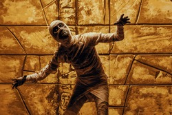 Scary evil mummy climbs out of an ancient Egyptian tomb. Halloween. Ancient Egyptian mythology.