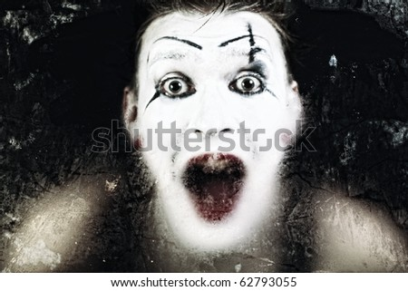 Scary face screaming mime for murky glass